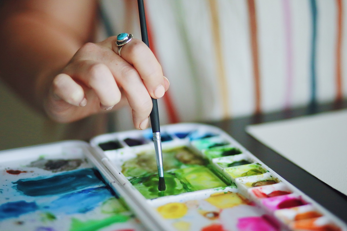 woman painting with watercolors