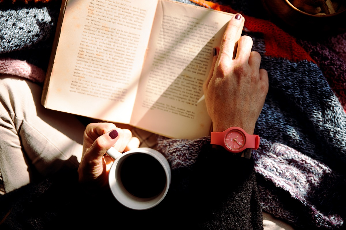 reading a book and learning with a cup of coffee